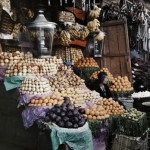 A woman sits with her fruits for sale. Photo Credit: Gervais Courtellemont and W. Robert Moore for National Geographic