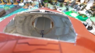 Hole in the nose. The original shape was a mouthwash bottle built up with styrene plastic sheet and putty. Click for larger.